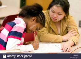 after school study tutor working with student and studies after school study program