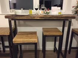 industrial mill style reclaimed wood breakfast bar two stools