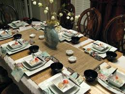 traditional japanese dinner table japanese dinner table a family prepare octopus dumplings around the
