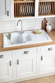 cl kitchen carisbrookeivoryframed closeup2 kitchen sinks metal ceramic kitchen sinks diy at bq