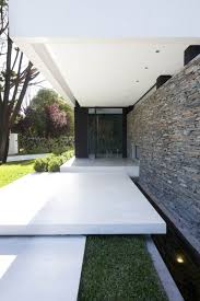 handsome exterior house of dainty entrance design with beautiful