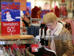 retailers slash prices to lure post holiday shoppers photos and