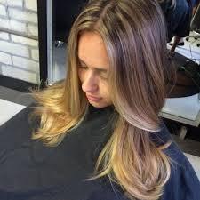 layered haircuts with blonde highlights women medium haircut