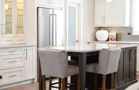 kitchen with black island and white cabinets why contrasting kitchen islands add a pop of color to your