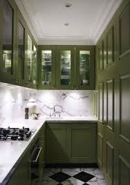 dark olive green shaker style kitchen cabinets with marble