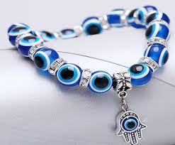 blue eye bracelet images Blue eye prayer bracelet with hamsa hand zen woman png