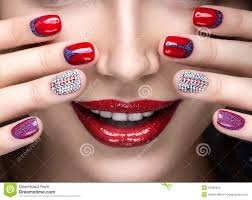 beautiful with a bright evening make up and red manicure with