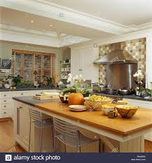 bowls of fruit on large island unit with breakfast bar in modern