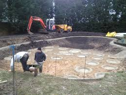 large natural pond for a water garden installing the liner