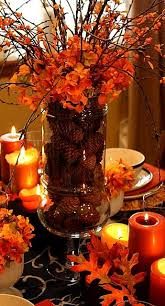 fall table centerpieces leaves and orange candles make for the intimate