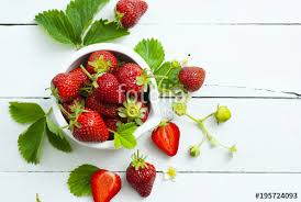 fruits flowers fresh ripe and ripe strawberry fruits flowers leaves on