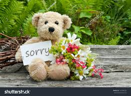 teddy bear writing paper teddy bear flowers card lettering sorryflowersteddy stock photo teddy bear with flowers and card with lettering sorry flowers teddy