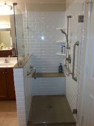 modern master bathroom with high ceiling handheld showerhead