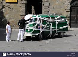 write on paper guests write on paper attached to a vw campervan covered in stock stock photo guests write on paper attached to a vw campervan covered in traditional white ribbon as a wedding car in cortona tuscany italy