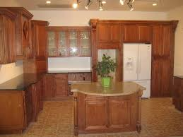 elegant dark brown color maple kitchen cabinets featuring double