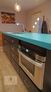 best 25 blue kitchen island ideas on pinterest painted island laminate wilsonart countertop and clayhaus ceramics 3 dimensional backsplash as the centerpiece this is beautifully offset by contemporary dark wood