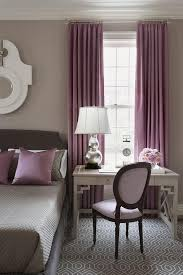 gray and purple bedroom features walls painted warm gray lined