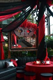 red and black decor at a masquerade ball party http www