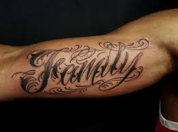 custom lettering on inner bicep chronic ink family