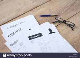 Resume Applications Resume Applications On Wooden Desk Ready To Be Reviewed Stock