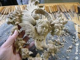 ornamental woodcarver damiaens carving a rococo ornament