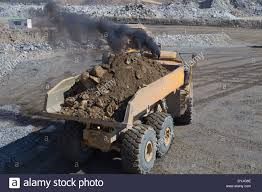 volvo dump truck a volvo dump truck reverses in a large open cast copper mine stock