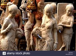 carving of buddhist asian garden statues