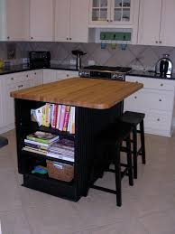 glass countertops kitchen island with butcher block lighting