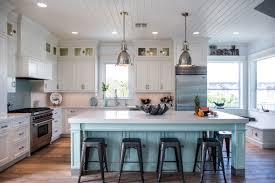 blue kitchen island and white cabinets coastal style white kitchen with blue island cabinets
