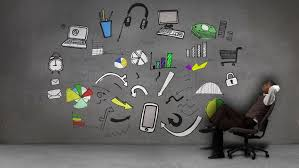 businessman with diary organizing business icons on grey wall