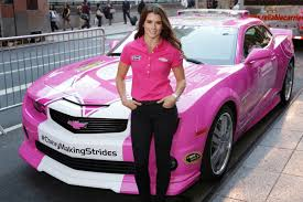 pink cars high heels and flashes danica patrick helps fight breast