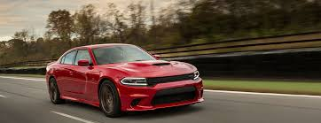 a dodge charger 2016 dodge charger vs 2016 ford taurus sho which one does it better