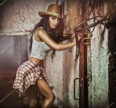 beautiful brunette with country look indoors shot in stable