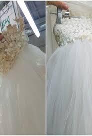 wedding dress restoration embellished wedding dress undergoes wedding gown restoration
