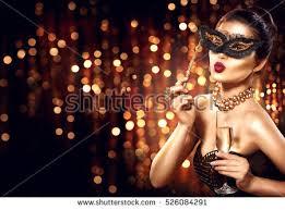 mask party beauty woman celebrating chagne wearing stock photo