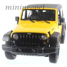 yellow jeep maisto 31676 2014 14 jeep wrangler 1 18 diecast model car yellow