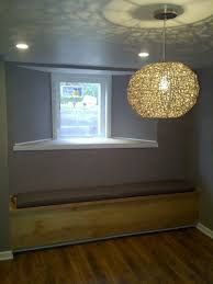 bench seat with added storage under an egress window nice idea