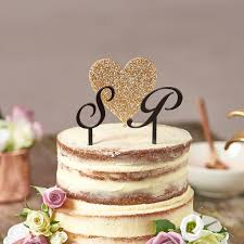 wedding cake toppers initials heart with initials wedding cake topper by suzy q designs