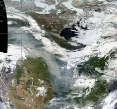 Alberta Wildfire Satellite Images by Smoke From Canada Fires Turns Skies Orange Across The Plains