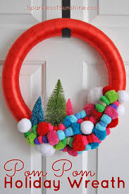 the most wonderful colorful pom pom holiday wreath sparkles of