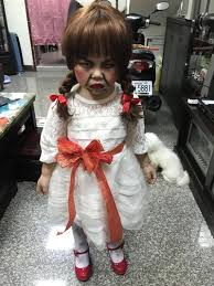 annabelle costume this kid is not thrilled to be wearing an annabelle costume at the