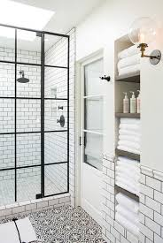 white and black bathroom with alcove shelves transitional bathroom