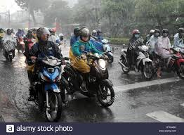 raincoat for bike riders ho chi minh city viet nam vietnamese people wear helmet