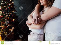 beautiful young couple in pajamas on nicely decorated christmas