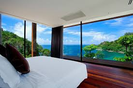 bedroom with beach view in naka phuket resort paradise in thailand