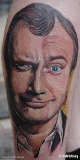 phil collins tattoo spectacular optical corp