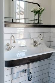 long bathroom sink with two faucets custom bathroom with cast iron trough sink by rafterhouse