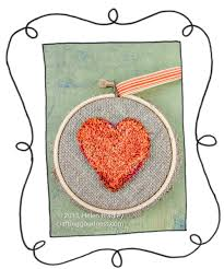 s punch needle in an embroidery hoop frame
