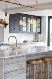 best ideas about wood kitchen island pinterest rustic reclaimed wood kitchen island with stools industrial light fixture and navy blue uppers