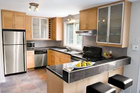 contemporary kitchen schluter com subway tiles on the backsplash porcelain tiles with granite look and brushed aluminum profiles match the appliances creating this contemporary kitchen